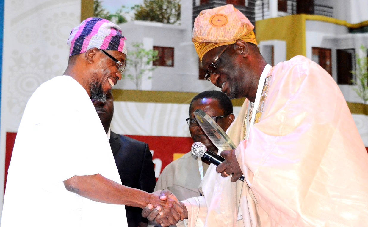 Governor State of Osun, Ogbeni Rauf Aregbesola receiving an Award of Fellowship from the President, Nigerian Institute of Building, Builder Tunde lasabi, during the 45th Builders' Conference/Annual General Meeting of the Nigerian Institute of Building, at International Conference Centre, University of Ibadan, Oyo State, on Tuesday 04/08/2015.