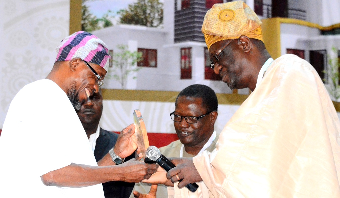 Governor State of Osun, Ogbeni Rauf Aregbesola receiving an Award of Fellowship from the President, Nigerian Institute of Building, Builder Tunde lasabi and Chairman,College of Fellows, Dachollom Jambol during the 45th Builders' Conference/Annual General Meeting of the Nigerian Institute of Building, at International Conference Centre, University of Ibadan, Oyo State, on Tuesday 04/08/2015.