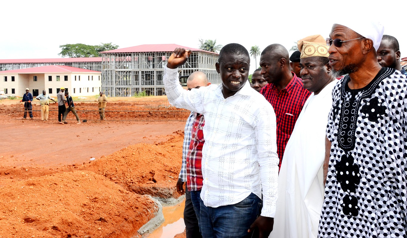 From Right - Governor State of Osun, Ogbeni Rauf Aregbesola and Site Engineer, Mr. Ogundele Adedamola, during an Inspection Tour to the ongoing  school building site at Osogbo High School on Saturday 29/08/2015.