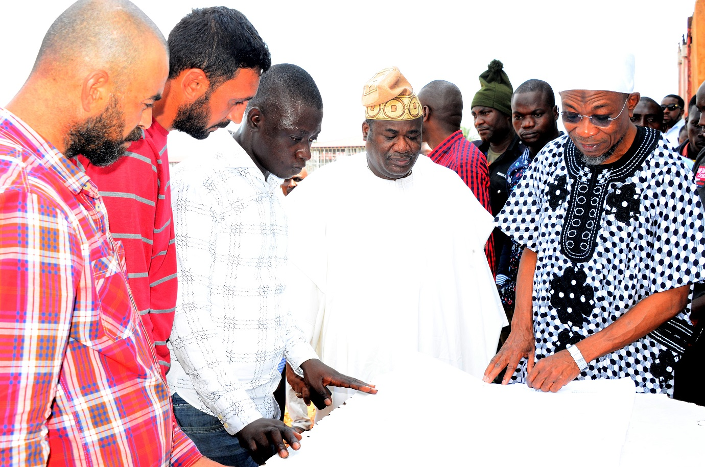 Governor, State of Osun, Ogbeni Rauf Aregbesola (right), Site Engineer, Ogundele Adedamola (3rd left),Chief Rotimi Obeisun (2nd right),Surveyor, Mr. Muray Yilmat (2nd left) and Foreman, Bektas Kocut (left), viewing the building prototype of Osogbo Grammar School, during an Inspection Tour to the ongoing school building site  at Osogbo high School on Saturday 29/08/2015.