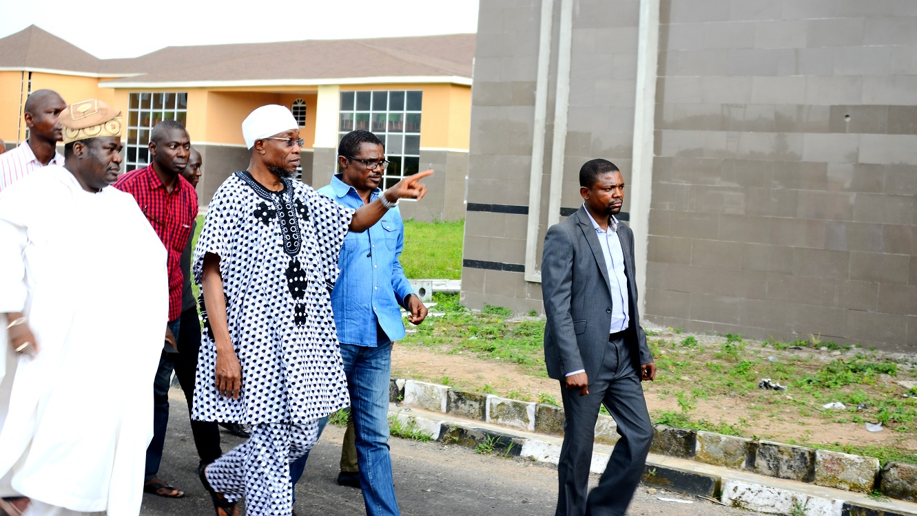Governor State of Osun, Ogbeni Rauf Aregbesola(middle); Chief Rotimi Obeisun(left) and Site Engineer, Mr. Gboyega Adeeyo (right). during an Inspection Tour to the ongoing  school building site at Ejigbo   high School on Saturday 29/08/2015.
