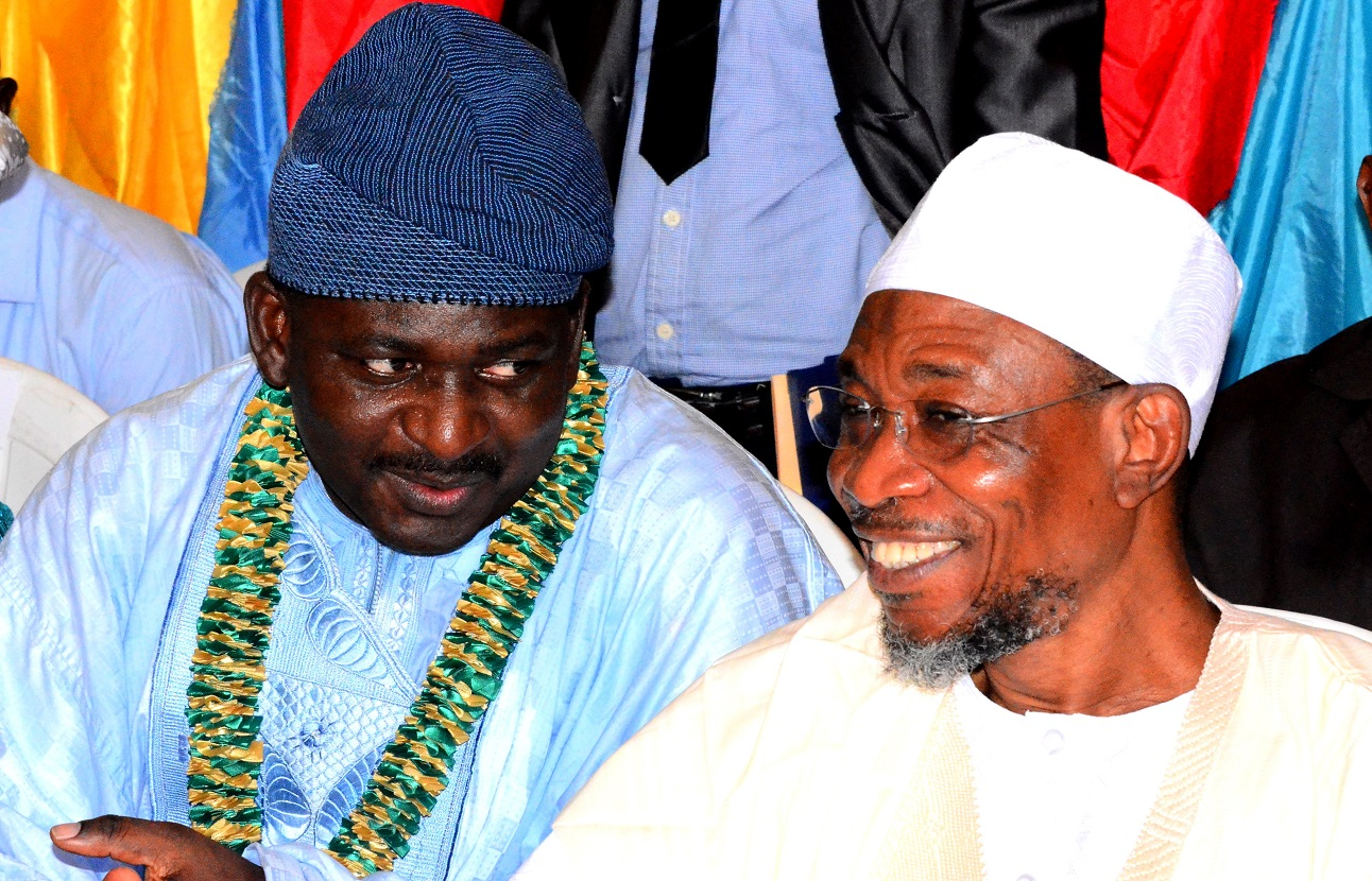 Governor, State of Osun, Ogbeni Rauf Aregbesola discussing with the Special Adviser to President Muhammadu Buhari on Media and publicity, Mr. Femi Adesina, during a thanksgiving reception organized in celebration of Adesina's new appointment, at Ipetumodu Township Hall, Ife-North Local Government, State of Osun, on Saturday, 22/08/2015.