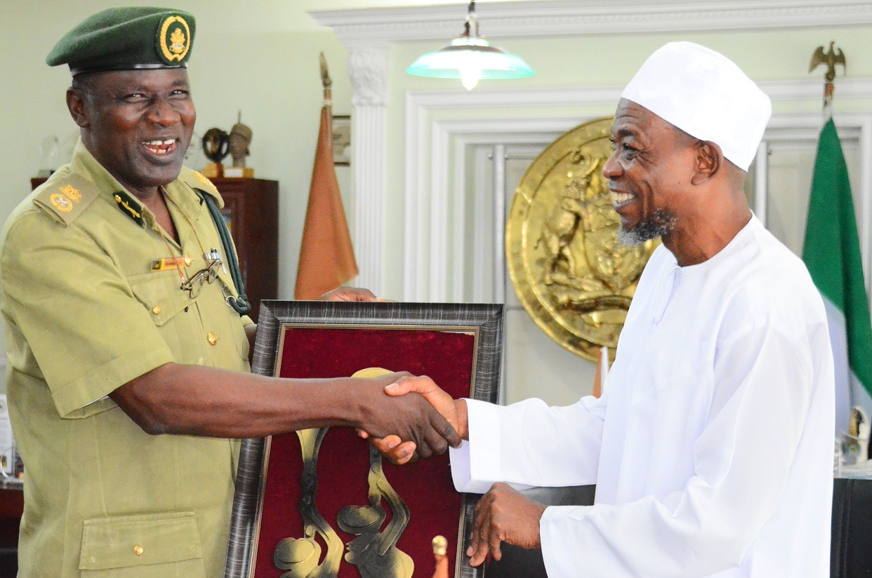 Governor State of Osun, Ogbeni Rauf Aregbesola (right) with the newly posted Controller of Prisons to Osun Command, Mr. Tajudeen Olalekan Kehinde, during a familiarization visit to the Governor in his office at Government Secretariat, Abere, Osogbo on Thursday 13/08/2015.