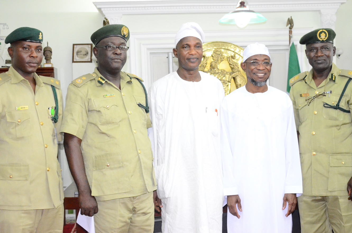 Governor State of Osun, Ogbeni Rauf Aregbesola (2nd right); Secretary to the State Government, Alhaji Moshood Adeoti (middle), newly posted Controller of Prisons to Osun Command, Mr. Tajudeen Olalekan Kehinde (right), Deputy Controller of Prisons Administration, Mr. Charles Esan (2nd left) and Command Public Relations Officer, Mr. Olusola  Adeotan (left), during a familiarization visit to the Governor in his office at Government Secretariat, Abere, Osogbo on Thursday 13/08/2015.