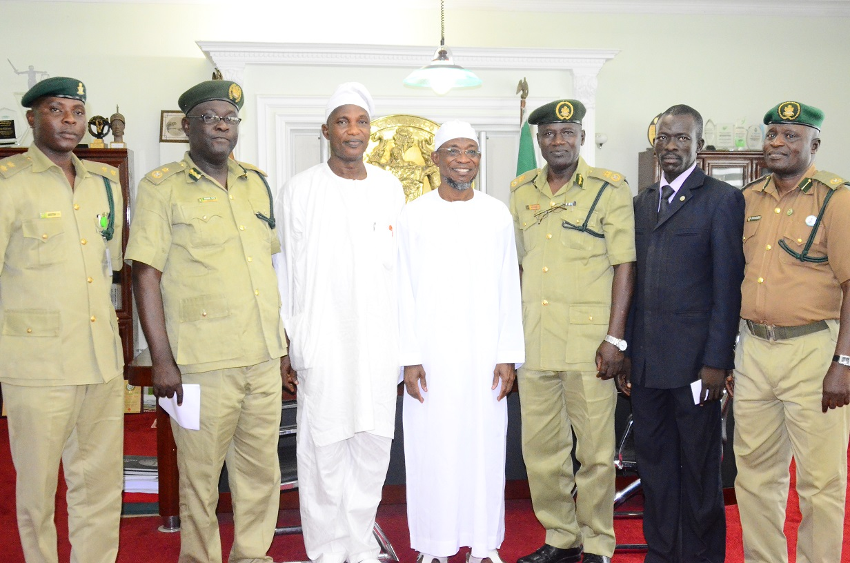 Governor State of Osun, Ogbeni Rauf Aregbesola (middle); Secretary to the State Government, Alhaji Moshood Adeoti (3rd left), newly posted Controller of Prisons to Osun Command, Mr. Tajudeen Olalekan Kehinde (3rd right), Deputy Controller of Prisons Administration, Mr. Charles Esan (2nd left); Command Public Relations Officer, Mr. Olusola Adeotan (left), Assistant Controller of Prisons Operations, Mr. Suhaib Ayodeji (right) and Mr. Ramon Olayiwola (2nd right), during a familiarization visit to the Governor in his office at Government Secretariat, Abere, Osogbo on Thursday 13/08/2015.