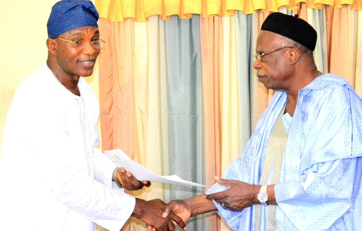 Secretary to the State Government of Osun, Alhaji Moshood Adeoti, representing the governor, collecting Senate Condolence Letter from Senator Abdullahi Adamu, during the condolence visit to the Governor on the death of Ooni of Ife, Oba Okunade Sijuwade, at the Government House, Osogbo on Thursday 20/08/2015.