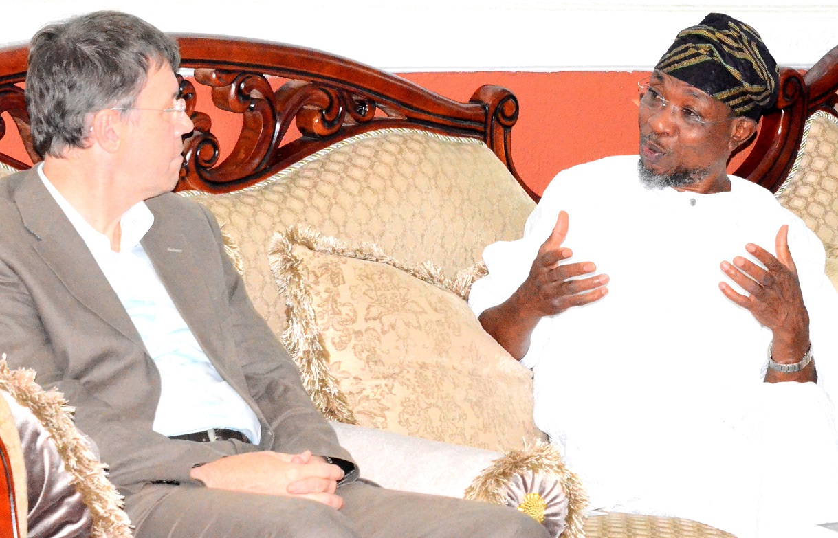 Governor State of Osun, Ogbeni Rauf Aregbesola discussing with the Leader, Swiss Embassy Delegation, Dr. Daniel Caregn, during a courtesy visit to the Governor, at Government House, Osogbo, last Friday