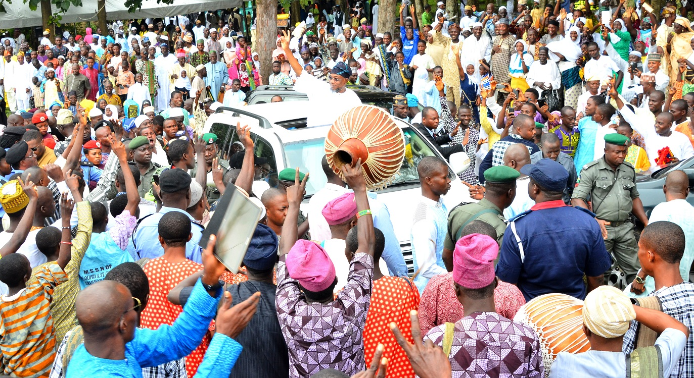 Governor State of Osun, Ogbeni Rauf Aregbesola on top of vehicle acknowledging cheers from Muslims faithful, during 2015 Eid-el-kabir celebration in Osogbo, on. Thursday 24/09/2015.