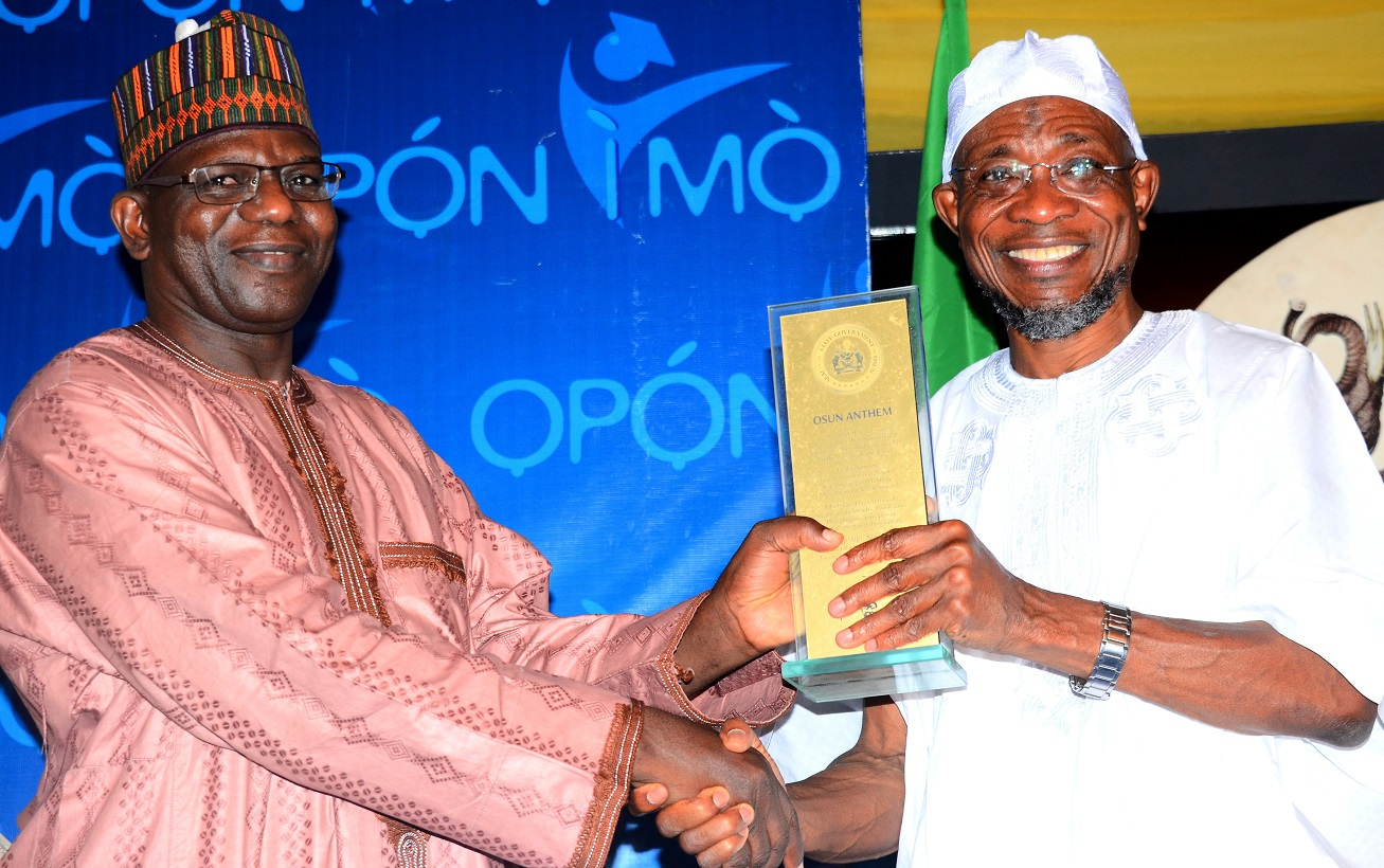 Governor, State of Osun, Ogbeni Rauf Aregbesola (right) presenting the State Anthem to National President, Nigerian Statistical Association (NSA), Dr. Muhammed Tumala, during a dinner party, organized by the State Government, at Government House, Osogbo, at the weekend