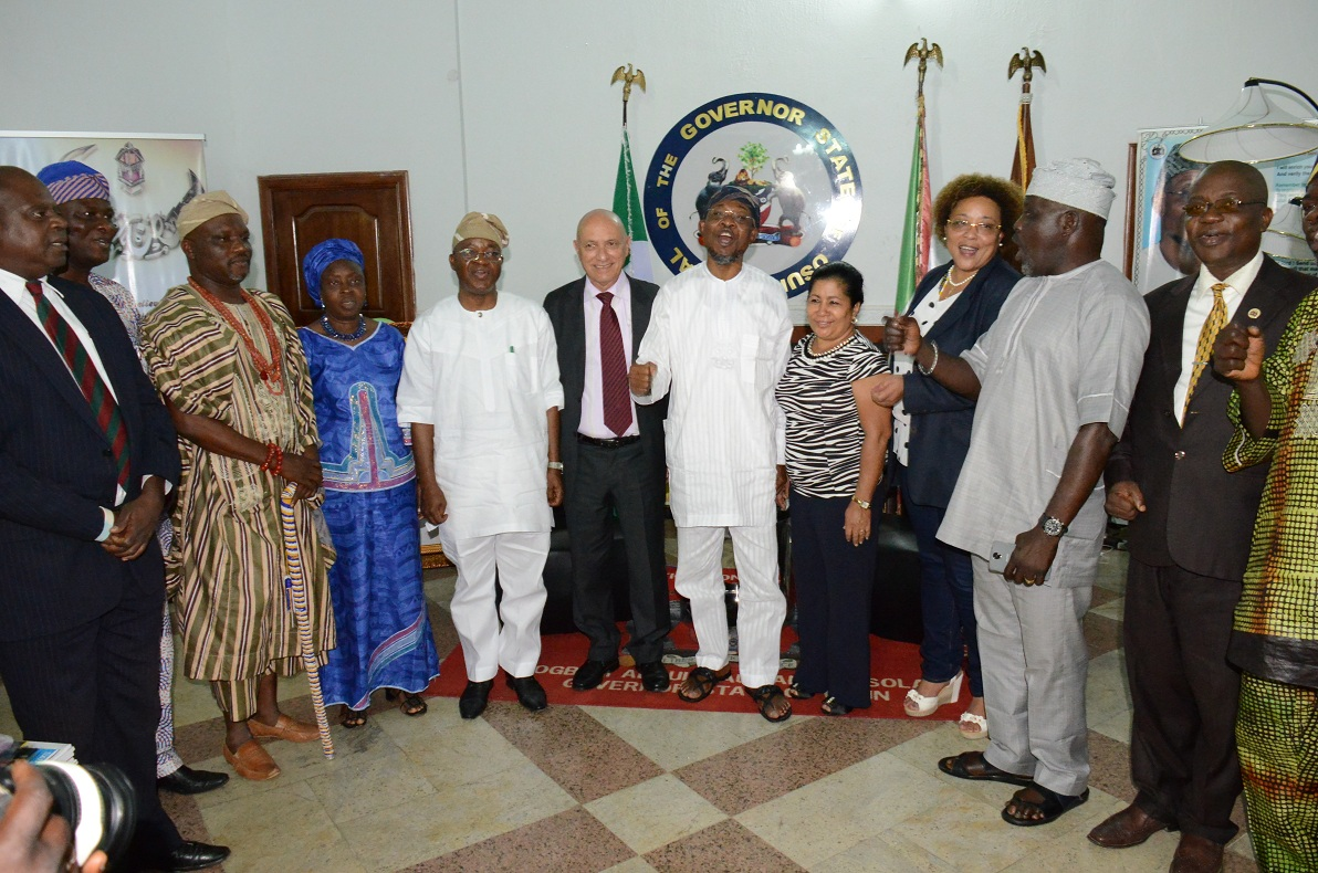 Governor State of Osun, Ogbeni Rauf Aregbesola (middle); Cuban Ambassador to Nigeria, Carlos Trejo Sosa (6th left); his wife Nelba Peirg Morales (4th right), Member of Nigerian Cuba Friendship Business and Cultural Association, Hon. Demola Doherty (left); President, Nigeria-Cuba Friendship Business and Cultural Association, Comrade Abdul Kareem Motajo (2nd right); Deputy of the Mission, Miriam Morales Palmero (3rd right); Chief of Staff to the Governor, State of Osun, Alhaji Gboyega Oyetola (5th left), Permanent Secretary Homes Affair, Culture Tourism,Mrs Olajumoke Bello (4th left); Executive Secretary State of Osun Council for Art and Culture, Oyetunde Oyesiji (3rd left) and others, during a condolence visit to the governor by the Cuba Ambassador who lead the Delegation over the demise of Ooni of Ife, Oba Okunade Sijuwade, at Government House, Osogbo on Monday 31/08/2015.