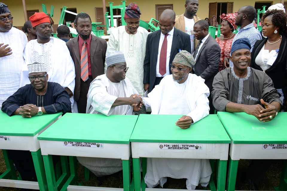 Front row from left,State Chairman, Universal Basic Education Board, Prince Felix Awofisayo;Deputy Executive Secretary, Universal Basic Education (UBEC), Dr Yakubu Gambo (middle), representing the Executive Secretary; Governor Rauf Aregbesola and Secretary to Osun Government, Alhaji Moshood Adeoti,during the National Flag off ceremony of Tables and Chairs to be distributed to thirty six States and FCT, SUBEBs in Nigeria by Federal Government, at L.A Government Middle School, Ayetoro, Osogbo on Tuesday 08-09-2015