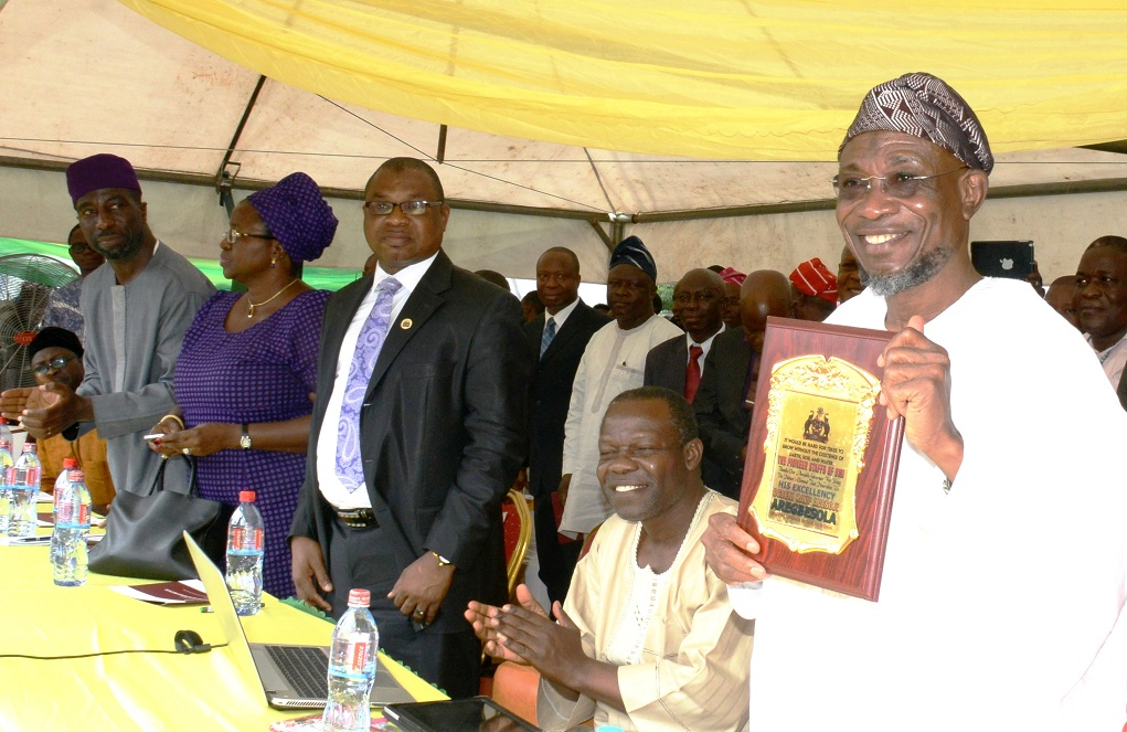From right, Governor State of Osun, Ogbeni Rauf Aregbesola, displaying a plaque presented to him by one of the Trainers in Mechatronics from Germany; Guest Speaker, Mr. Ola Abraham; Managing Director, Osun State Investment Company Limited,  Mr. Bola Oyebamiji and Late Bola Ige,s Daughter, Mrs Funsho Adegbola and her brother who was the former Commissioner for Lands and Physical Planning, Mr. Muyiwa Ige, during the official commissioning of Bola Ige Mechatronics Institute in Esa Oke on Thursday 10-09-2015