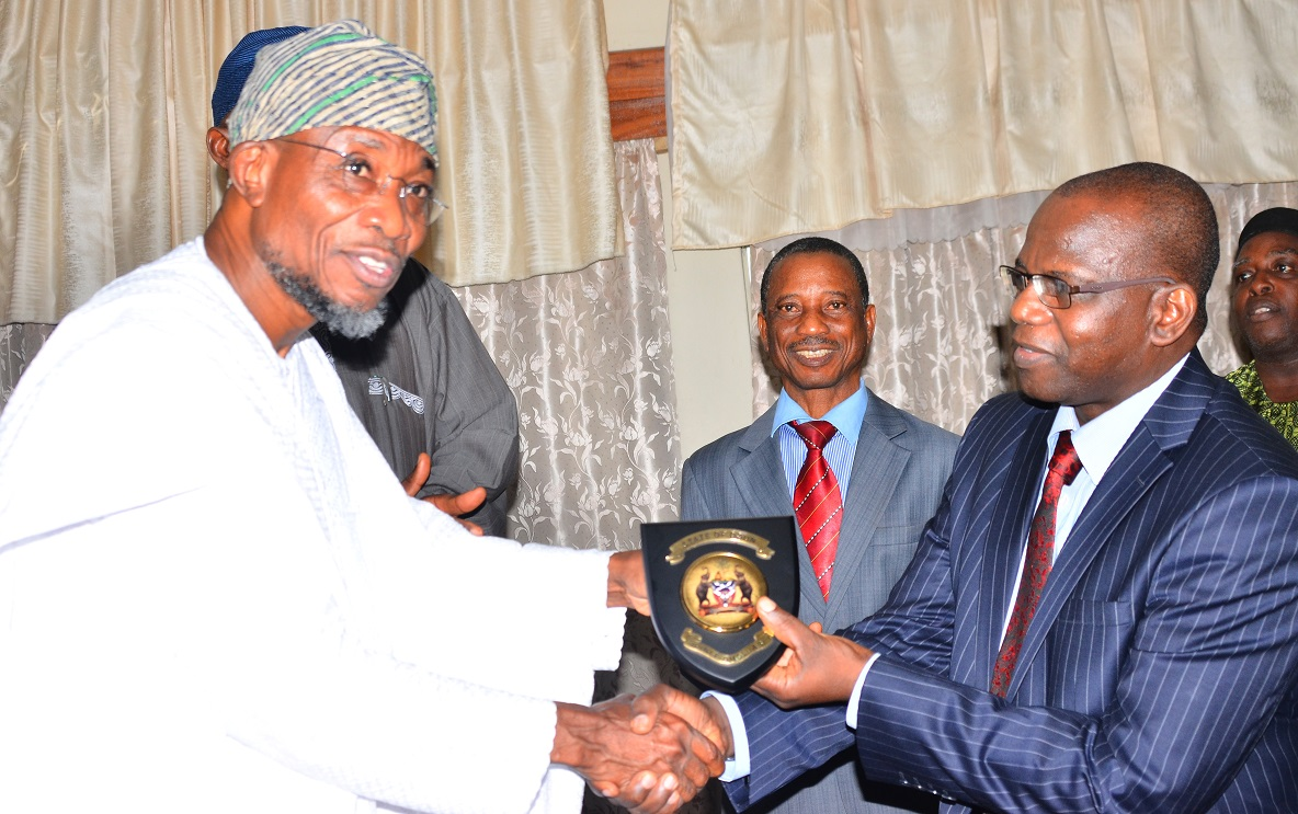 Governor, State of Osun, Ogbeni Rauf Aregbesola, presenting the State Emblem to National President, Nigerian Statistical Association (NSA), Dr. Muhammed Tumala, during a courtesy visit to the Governor, at Government Secretariat, Abere, Osogbo, on Tuesday 08/09/2015.