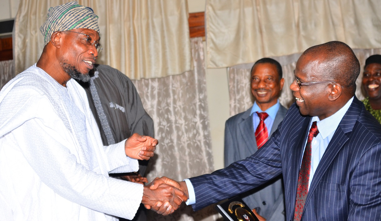 Governor, State of Osun, Ogbeni Rauf Aregbesola exchanging pleasantries with the National President, Nigerian Statistical Association (NSA), Dr. Muhammed Tumala, during a courtesy visit to the Governor, at Government Secretariat, Abere, Osogbo, on Tuesday 08/09/2015.