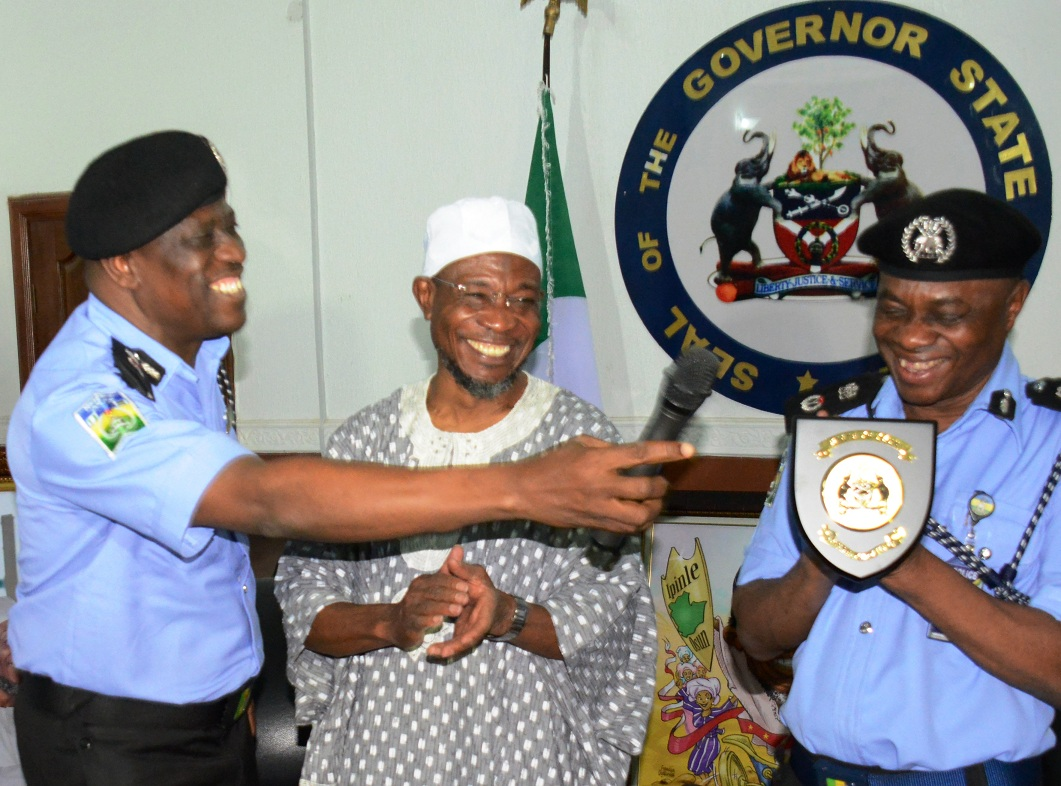 Governor Rauf Aregbesola of Osun, Welcoming the newly posted Police Commissioner to Osun, Mr Kola Sodipo. With them is the outgoing Police Commissioner, Mr Abubakar Marafa, during the farewell programme of the outgoing and introduction of the new police commissioner, at the Government House, Osogbo, the State of Osun on Wednesday 02-09-2015