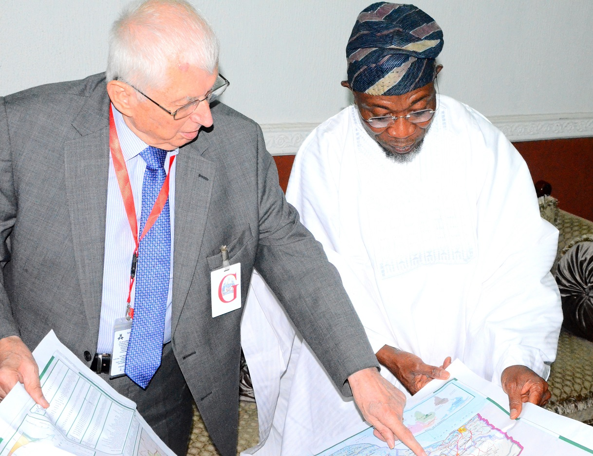 Governor State of Osun, Ogbeni Rauf Aragbesola and Executive Chairman Safari Book Ltd, Chief Joop Berkhout OOn during the Presentation of School Wall Map Capturing State of Osun to the Governor, at Government House, Osogbo