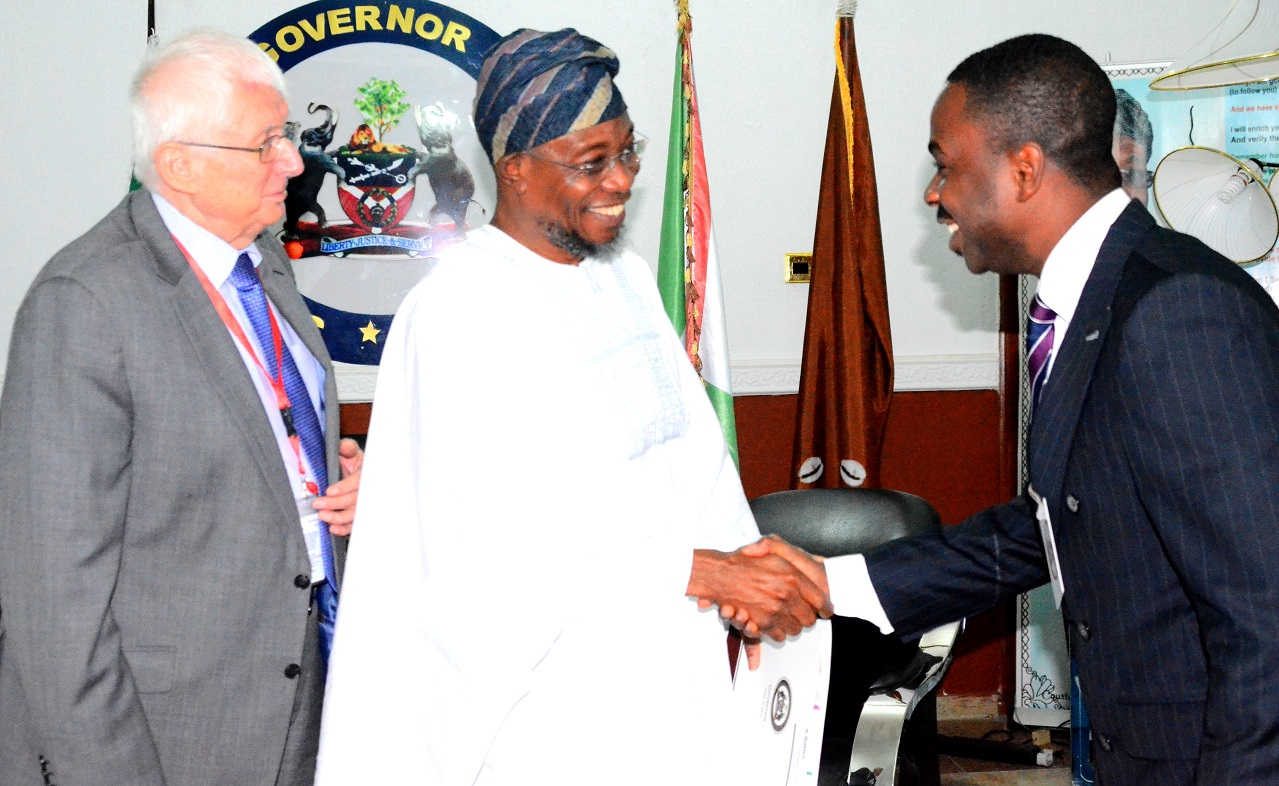 Governor State of Osun, Ogbeni Rauf Aragbesola (middle); Executive Chairman Safari Book ltd, Chief Joop Berkhout OOn (left) and Director, Marketing & Business Development, Safari Book Ltd, Chief Joop George Berkhout, during the Presentation of School Wall Map Capturing State of Osun to the Governor at Government House in Osogbo
