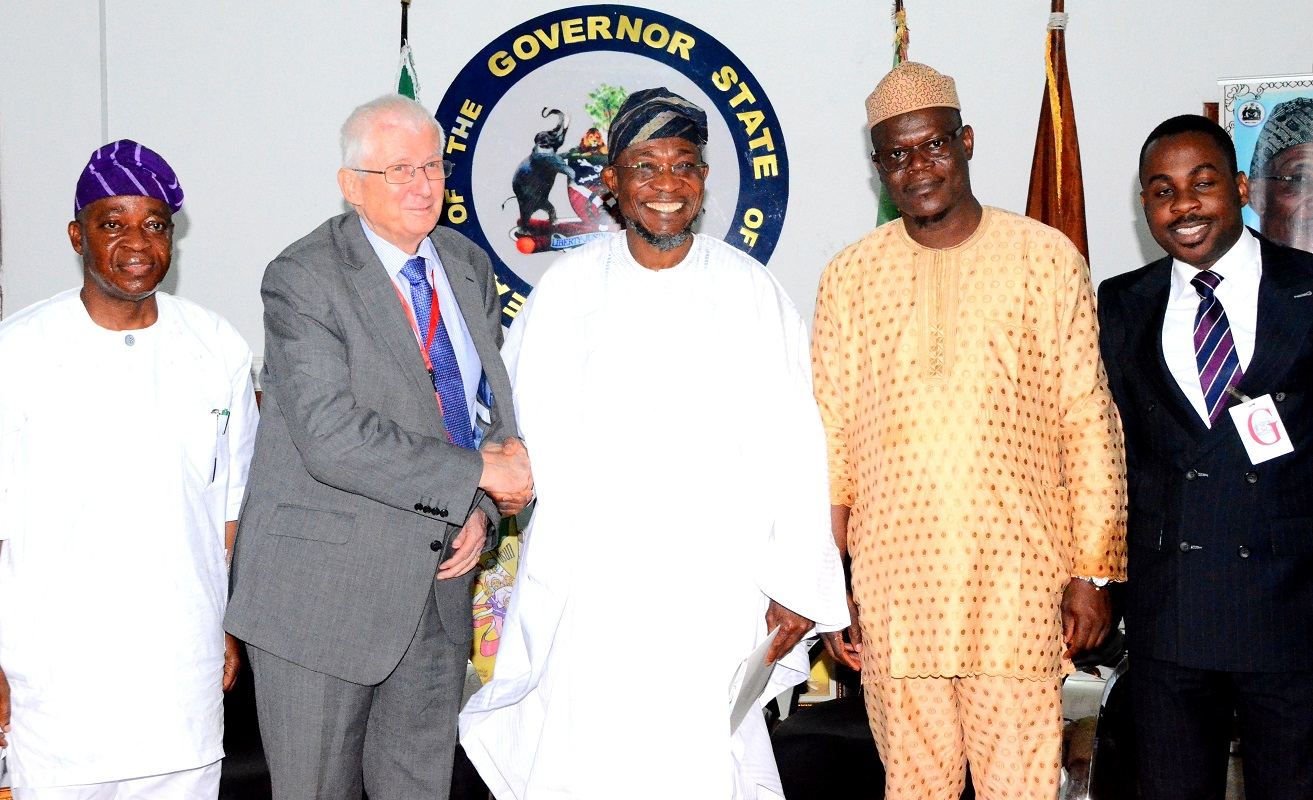 Governor State of Osun, Ogbeni Rauf Aragbesola (middle); Chief of Staff to the Governor, Alhaji Gboyega Oyetola (left),Executive Chairman Safari Book ltd, Chief Joop Berkhout OOn (2nd left), Director, Marketing & Business Development, Safari Book Ltd, Chief Joop George Berkhout (right) and Former Commissioner for Regional Integration and Special Duties, Hon. Ajibola  Basir (2nd right) during the Presentation of School Wall Map Capturing State of Osun to the Governor at Government House, Osogbo