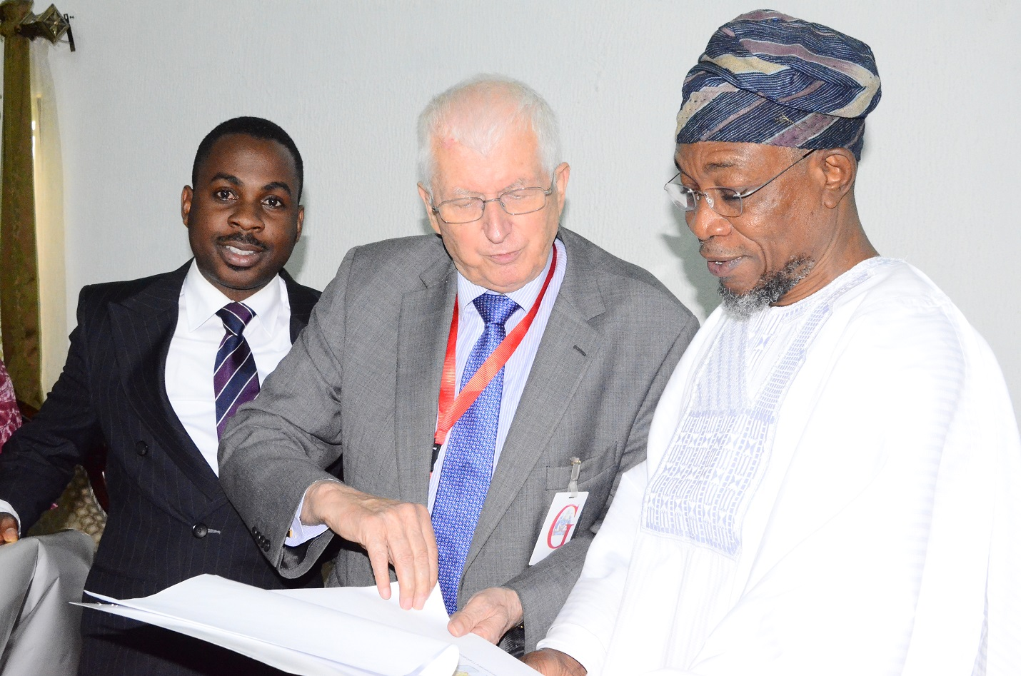 Governor State of Osun, Ogbeni Rauf Aragbesola (right); Executive Chairman Safari Book ltd, Chief Joop Berkhout OOn (middle) and Director, Marketing & Business Development, Safari Book Ltd, Chief Joop George Berkhout (left), during the Presentation of School Wall Map Capturing State of Osun to the Governor at Government House, Osogbo