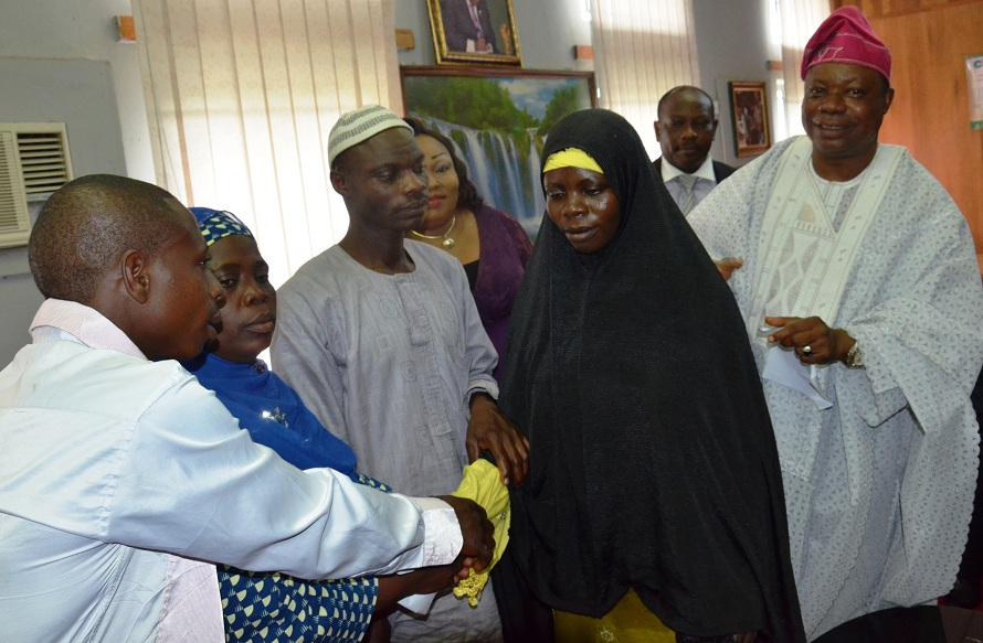 Former Special Adviser to Governor Rauf Aregbesola on Youths, Sports and Special Needs, Comrade Biyi Odunlade {right}, handing over a woman, Mrs. Kafayat azeez, after she has been rehabilitated by the State Government; her husband, Mr. Azeez Jimoh {center}; Kafaya's family, Mrs Baliqees Ayobami {2nd left}; Permanent Secretary, Ministry of Youths, Sports and Special Needs, Dr Akinyinka Eso {2nd right}; Director of Special Needs in the Ministry, Mrs Taiwo Oladunjoye, during the handing over ceremony of displaced people to their families after been rehabilitated by Aregbesola's administration, at the Permanent Secretary's office, Government Secretariat, Abere, Osogbo, at the weekend