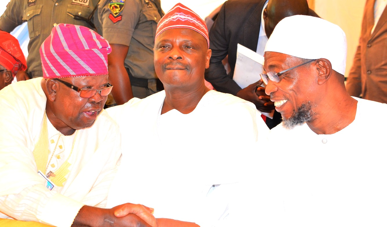 Governor State of Osun, Ogbeni Rauf Aregbesola (right);  Former Governor of Kano State, Senator Rabiu  Musa Kwankwaso (middle) and Chairman of the Occasion, Chief Tunde Ponnle (left), during the 2nd Education Summit at Igbajo Polytechnic,Igbajo, State of Osun, on Thursday 22/10/2015.