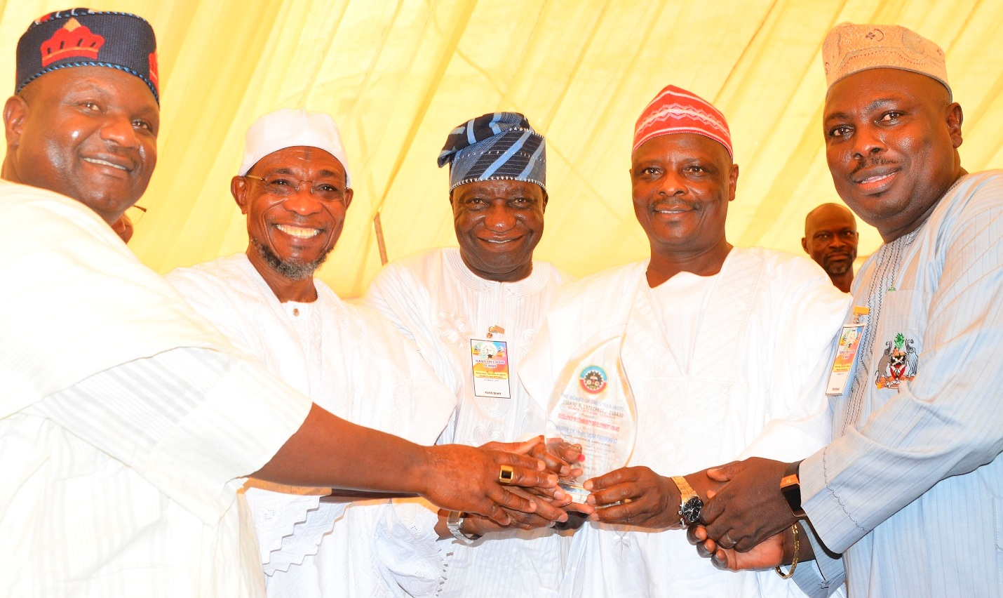 Governor State of Osun, Ogbeni Rauf Aregbesola (2nd left);  Former Governor of Kano State, Senator Rabiu  Musa Kwankwaso (2nd right), former Commissioner for Information and Strategy, State of Osun, Hon. Sunday Akare (right), Chairman All Progressive Congress (APC), State of Osun, Prince Gbenga Famodun (left), and Registeral Joint Admission and Matriculation Board, Prof. Dibu Ojerinde (middle), during the 2nd Education Summit & Presentation of the Award of Excellence in Community Development to Former Governor, of Kano State, at Igbajo Polytechnic,Igbajo, State of Osun, on Thursday 22/10/2015.