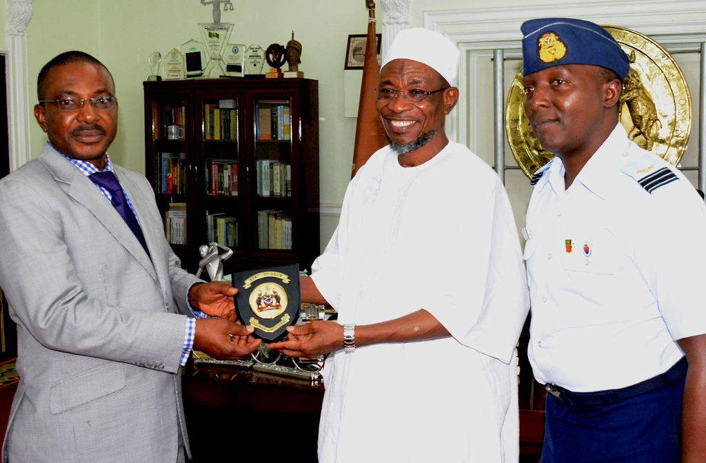 Osun Governor Rauf Aregbesola, presenting plaque to the Managing Director, Aeronautical Engineering and Technical Services Limited, Air Commodor Emmanuel Eze. With them is the Wing Commander Ridwan Abdullahi, during a courtesy visit to the Governor towards the completion of the MKO International Airport in his office, Abere, Osogbo