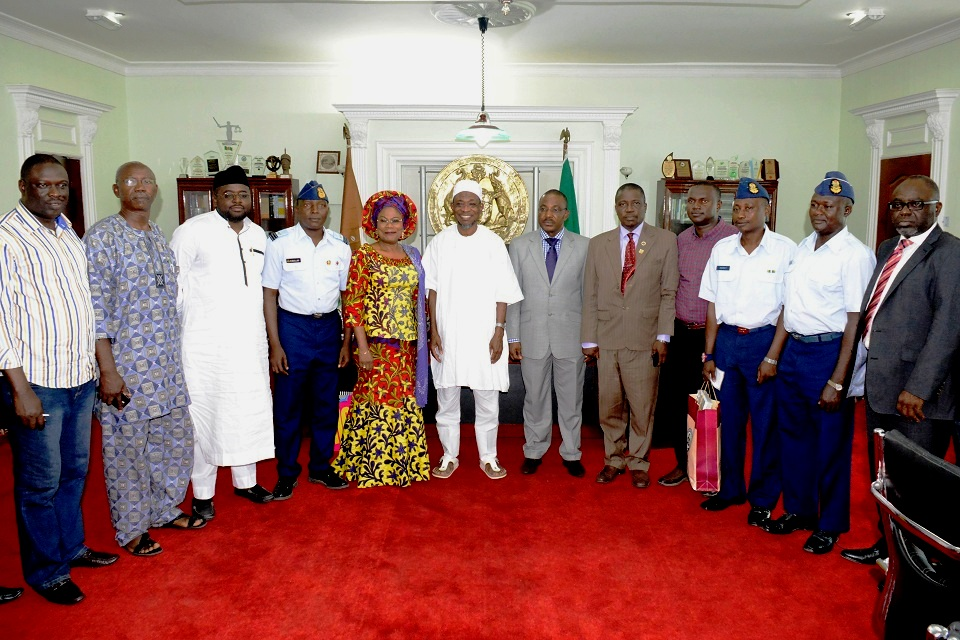 Governor, State of Osun, Ogbeni Rauf Aregbesola (middle); his deputy, Mrs Titi Laoye-Tomori; Managing Director, Aeronautical Engineering and Technical Services Limited, Air Commodor Emmanuel Eze (6th right); Osun Aiport Project Engineer, Engr.Aminu Suleiman (4th right); Wing Commander Ridwan Abdullahi (4th left); Warrant Officer, Sulman Tosho (2nd right); Warrant Officer, Abdullahi Tukur (3rd right), State Head of Service, Mr Sunday Owoeye (5th right) and others, during a courtesy visit to the Governor towards the completion of the MKO International Airport in his office, Abere, Osogbo