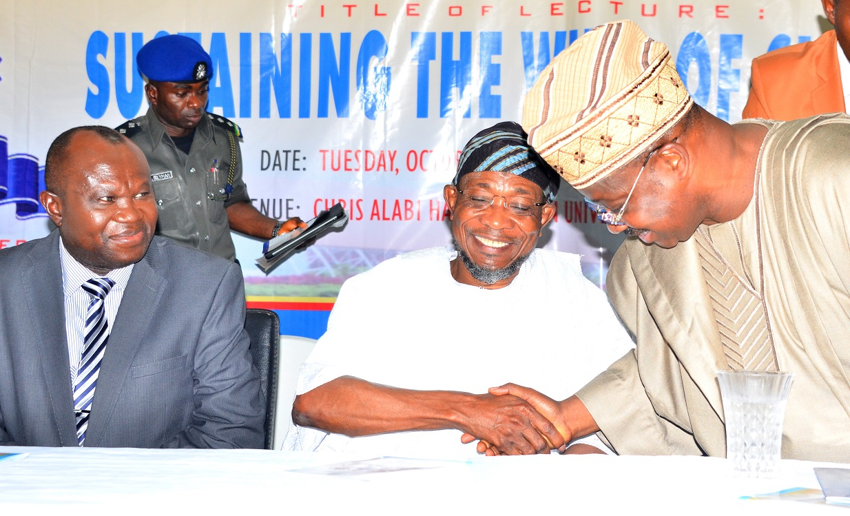 Chairman of the Occasion, Governor State of Osun, Ogbeni Rauf Aregbesola, handshake with Guest Lecturer, Oyo State Governor, Senator Abiola Ajimobi and Vice Chancellor, Bowen University, Prof. Matthews Ojo (left), during the first Distinguished Personality Lecture, organized by the Department of Political Science and Diplomatic Studies, Bowen University, Iwo, State of Osun on Tuesday 6/10/2015.