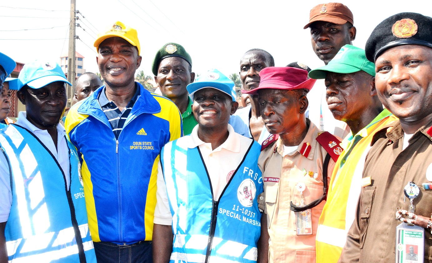 Secretary to Osun State Government, Alhaji Moshood Adeoti (2nd left), representing the governor, Osun State Commander, Federal Road Safety Commission (FRSC), Mr. Muhammed Husaini (third right), Executive Secretary, Orolu Local Government, Alhaji Bayo Oyegbemi (3rd left), Executive Secretary, Ede North Local Government, Dr. Tiamiyu Bello (left) and others, during the FRSC Ember Months Sensitization in Osogbo on Saturday 17-10-2015.