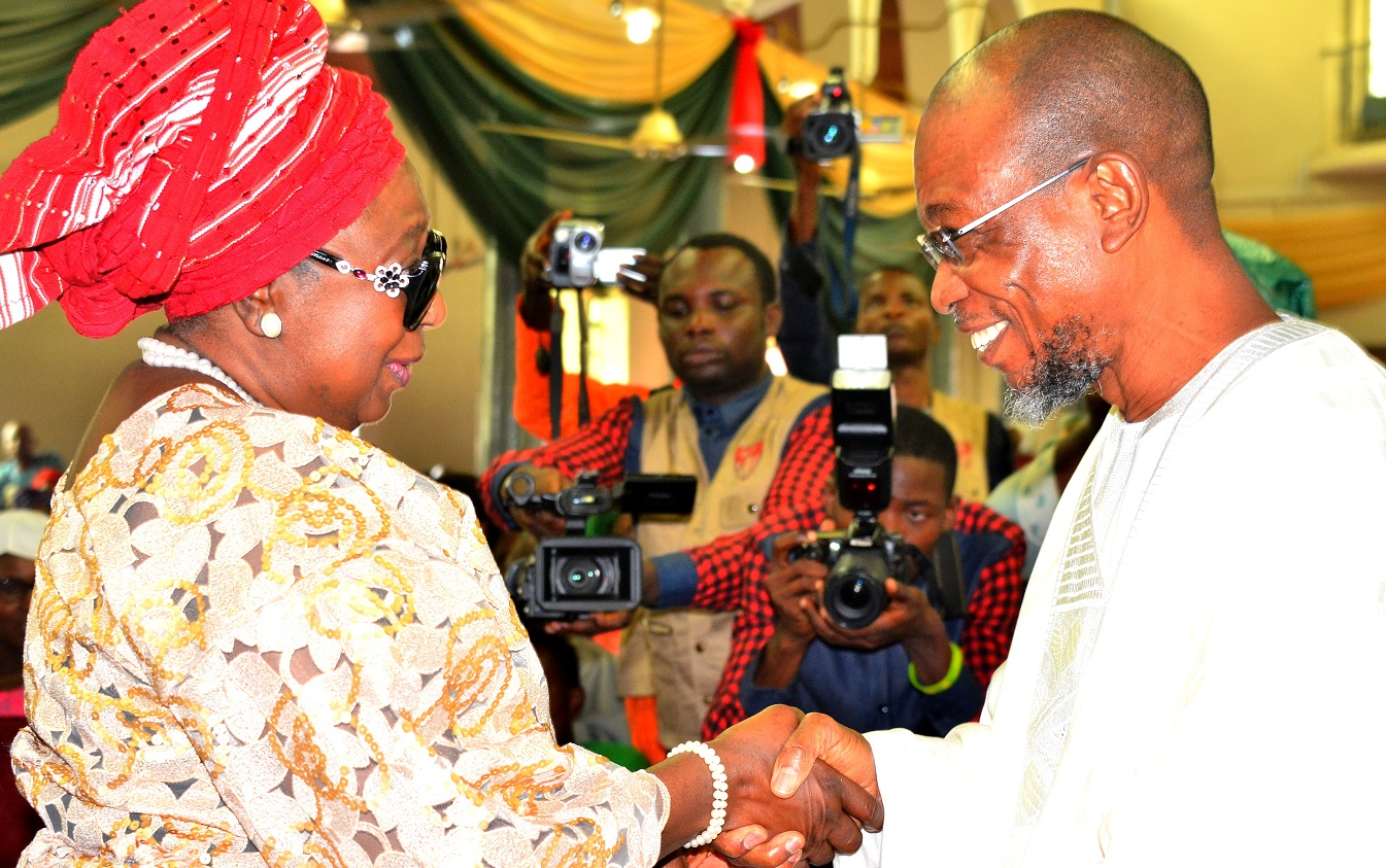 Governor State of Osun, Ogbeni Rauf Aregbesola with Former State Deputy Governor, Mrs. Erelu Olusola Obada, during the Funeral Service Of Chief Albert Olokunle Apara, at Cathedral Church of St. John Iloro, Ilesa, State of Osun, on Friday 23/10/2015.