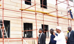 Governor State of Osun, Ogbeni Raruf Aregbesola, accompaning by the Site Engineer, Ogundele Adedamola on the inspection tour of the on-going constriction site of  Osogbo High School on Monday 19-10-2015.