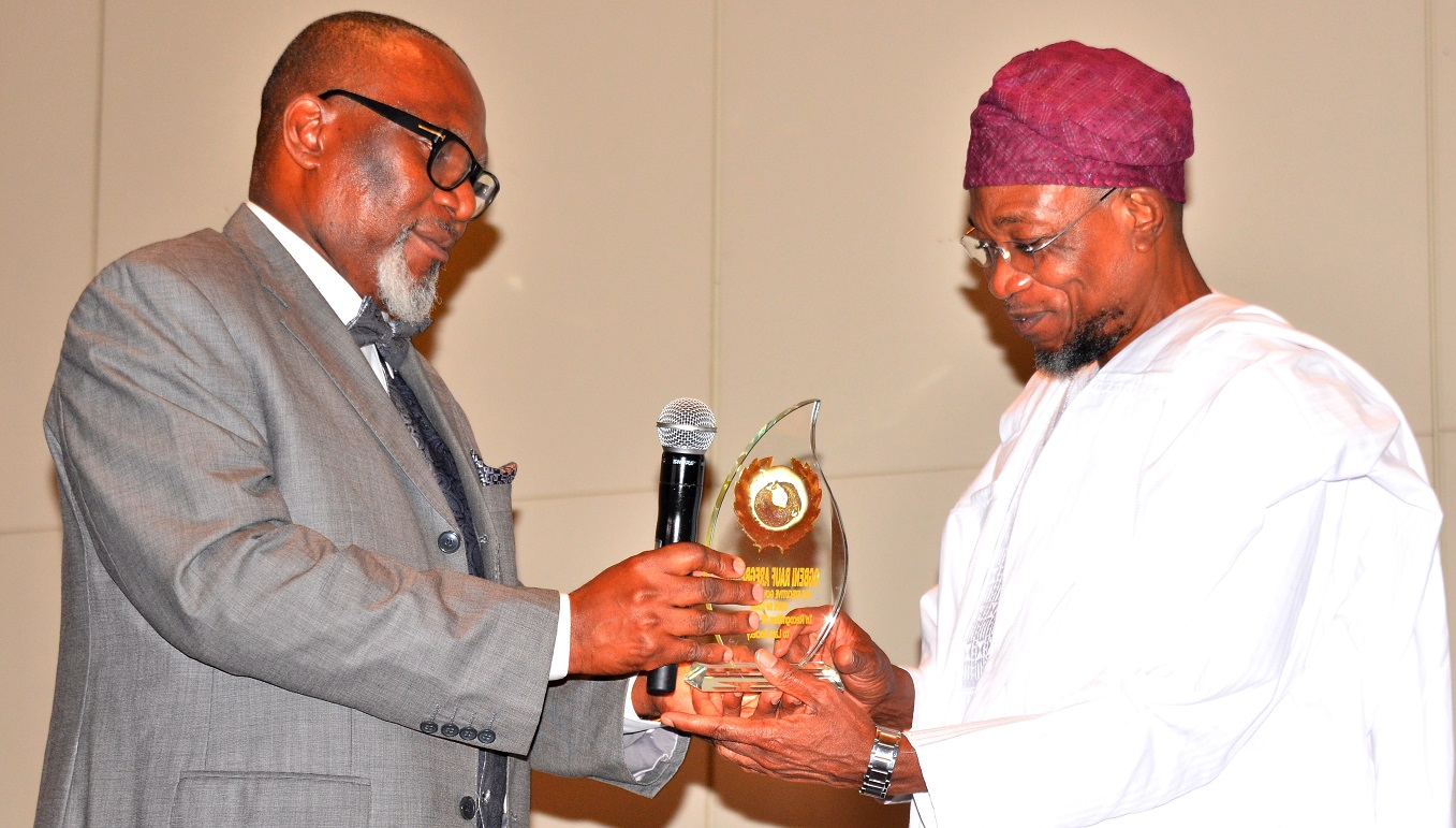 Head, Department of Commercial & Industrial Law, Prof. Joseph Abugu presenting Prestigious Award in Infrastructure Development and Management of Economy to Governor State of Osun, Ogbeni Rauf Aregbesola, during a dinner party organised by the Law Students of the University of Lagos, at Eko Hotel Lagos State recently