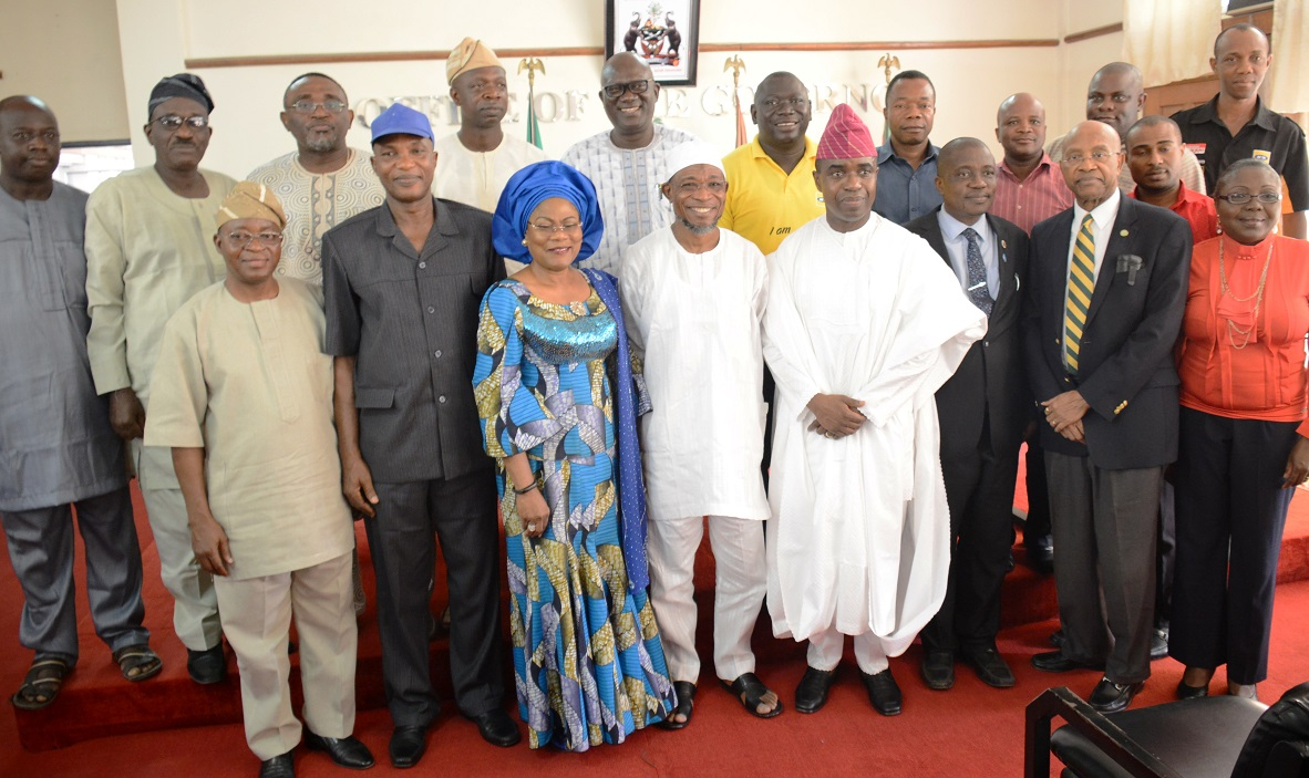 Governor State of Osun, Ogbeni Rauf Aregbesola (middle); his deputy, Mrs Titi Laoye-Tomori; SSG, Alhaji Moshood Adeoti (4th left); Chief of Staff, Mr. Gboyega Oyetola (3rd left); MTN Corporate Services Executive, Mr. Akinwale Goodluck (4th right), Director MTN Foundation, Mr. Denis Okoro (2nd right); Portfolio Manager MTN Foundation, Mrs. Foyinsola Oyebola (right); Initiator of MTN security Support to Osun, Mr. Tunbosun Oyintiloye (Back row with cap) and others, during the commissioning and  presentation of 5 Patrol Vehicles to Osun State Government as a beneficiary under the mtn foundation security support projects, at the Governor's Office, Abere, Osogbo on Tuesday 20-10-2015