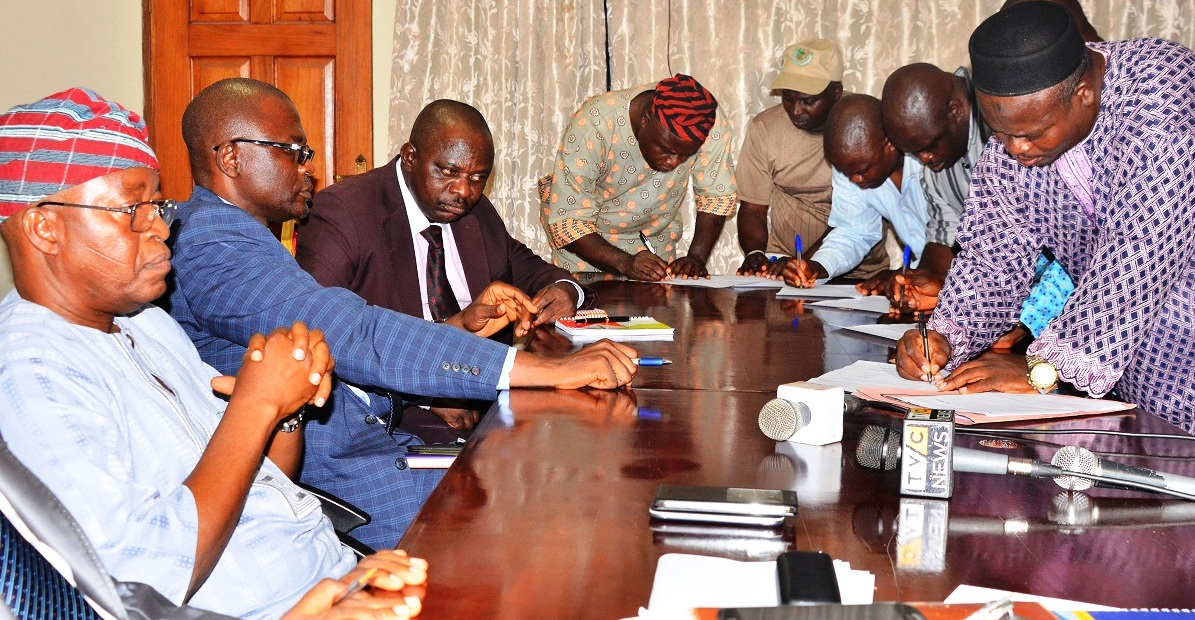Chief of Staff to Osun Governor, Alhaji Gboyega Oyetola (left); Permanent Secretary, Ministry of Information and Strategy, Engineer Olusegun Aduroja (2nd left), Permanent Secretary, Ministry of Finance, Mr. Leye Aina (3rd left), Chairman, Council of Academic Staff Unions of Osun State-owned Tertiary Institutions (CASUOSTI), Comrade Lasisi Ayanda (right) and other members of  (CASUOSTI), during the Signing of Memorandum of Understanding between Osun Government and CASUOSTI to call off strike, at Governor's office, Abere, Osogbo, on Tuesday 27-10-2015.