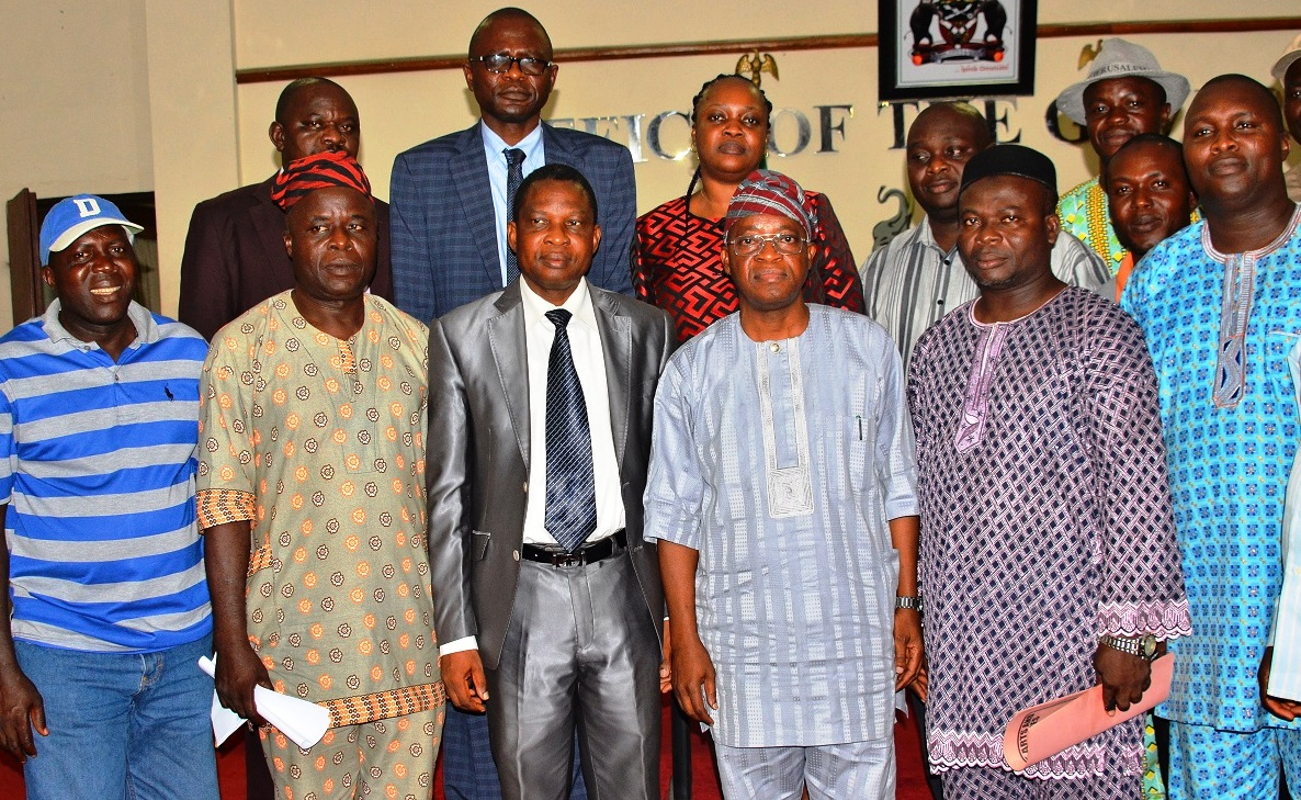 Chief of Staff to Osun Governor, Alhaji Gboyega Oyetola (3rd right); Chairman, Council of Academic Staff Unions of Osun State-owned Tertiary Institutions (CASUOSTI), Comrade Lasisi Ayanda (2nd right), Secretary (CASUOSTI), Comrade Olusegun Lana (right), Ex-officio (CASUOSTI), Comrade Jekayinoluwa Jacob (left), Permanent Secretary, Ministry of Human Resources and Capacity Building, Mr. Sunday Festus Olajide (3rd left) and others, during the Signing of Memorandum of Understanding between Osun Government and CASUOSTI to call off strike, at Governor's Office, Abere, Osogbo, on Tuesday 27-10-2015.
