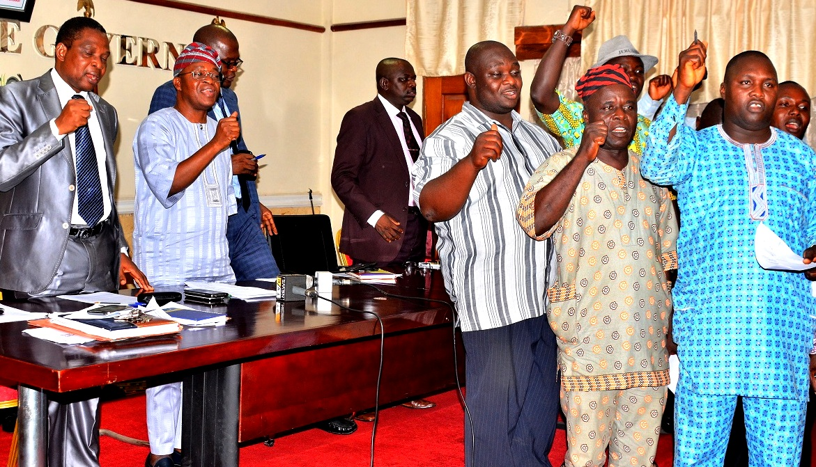Chief of Staff to Osun Governor,  Alhaji Gboyega Oyetola (2nd left); Permanent Secretary, Ministry of Human Resources and Capacity Building, Mr. Sunday Festus Olajide (left), Permanent Secretary, Ministry of Information and Strategy, Engineer Olusegun Aduroja (3rd left), Permanent Secretary, Ministry of Finance, Mr. Leye Aina (middle), Secretary, Council of Academic Staff Unions of Osun State-owned Tertiary Institutions (CASUOSTI), Comrade Olusegun Lana (right) and other members of  CASUOSTI during the Signing of Memorandum of Understanding between Osun Government and CASUOSTI to call off strike, at Governor's office, Abere, Osogbo, on Tuesday 27-10-2015.