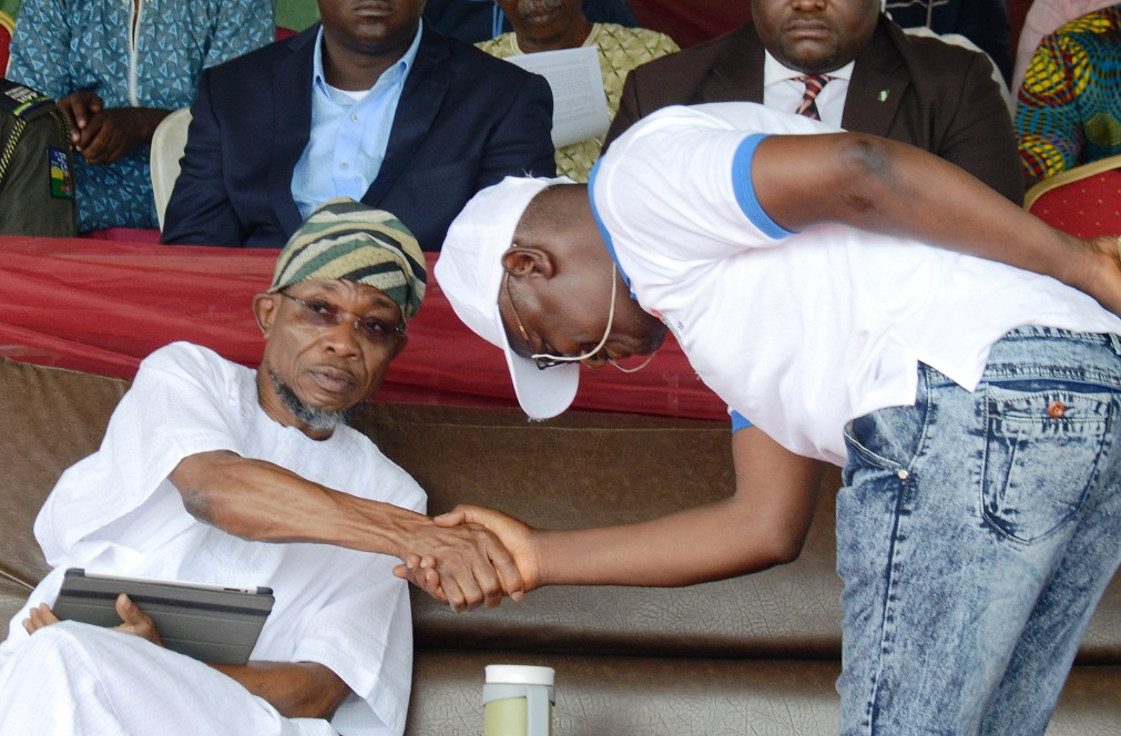 Governor State of Osun Ogben Rauf Aregbesola exchangng pleasantries with the State Chairman of Nigeria Union of Teachers (NUT), Comrade Wakili Alade Amuda, during the 2015 World Teachers Day celebrations, at the Government Technical College, Osogbo on Monday 05-10-2015
