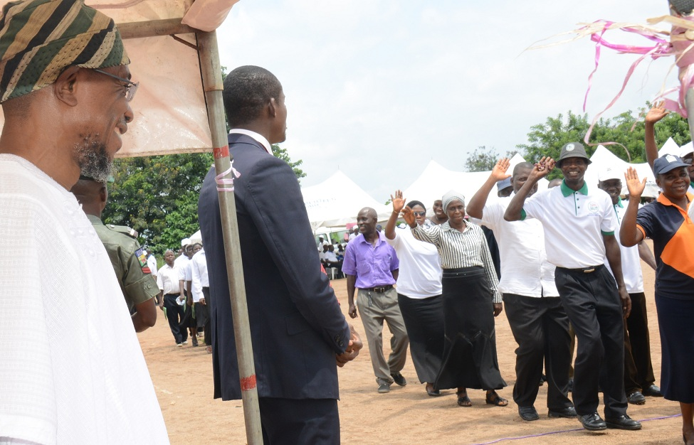 Governor State of Osun Ogben Rauf Aregbesola, taking salutes of march pass by Teachers,during the 2015 World Teachers Day celebrations, at the Government Technical College, Osogbo on Monday 05-10-2015