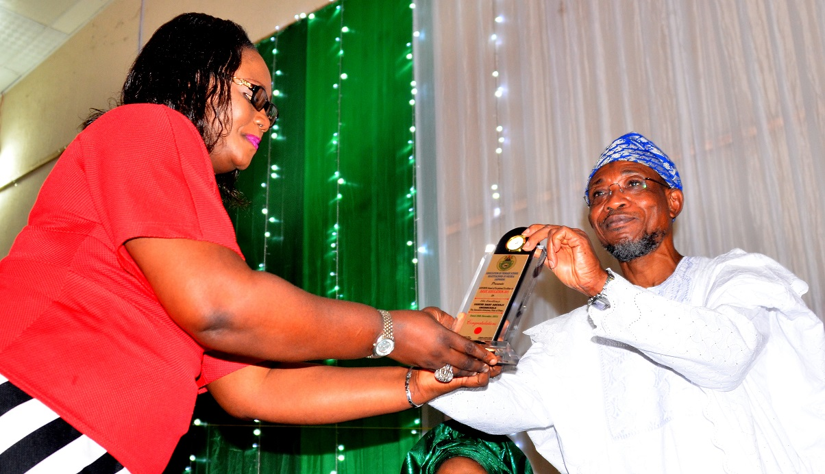 Senior Special Adviser to Anambra State Governor on Special Duties, Dr Amaka Akudo Presenting an Award of Excellence to Governor Rauf Aregbesola of Osun, on behalf of the Association of Primary Schools Headteachers of Nigeria (AOPSHON), at GMT Events Centre, Ring Road Area, Osogbo on Wednesday 18/11/2015.