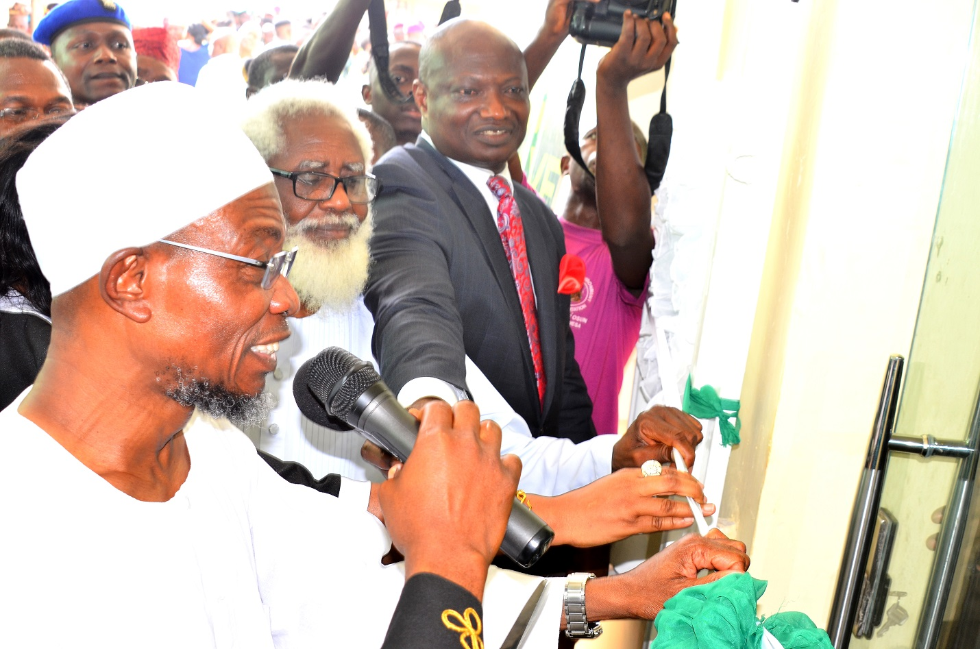 From left-  Governor State of Osun, Ogbeni Rauf  Aregbesola,  Chairman of Occasion, Dr. Yemi Farounbi and  Chief Executive Officer Rave FM 91.7, Mr. Femi Adefila during the Official Commissioning of Rav e F.M Radio at Agunbelewo,Area Osogbo, State of Osun, on Thursday 26/11/2015.