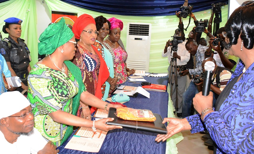 Governor State of Osun, Ogbeni Rauf Aregbesola; his wife and Chief Host, Sherifat; Wife of Oyo State Governor, Mrs Florence Ajimobi; Ekiti State Governor wife, Mrs Feyosetan Fayose and Special Adviser to Imo State Governor in Charge of Programmes, Mrs Ngozi Adamadualoh. Presenting gift to them is the United Nations Population Fund representative, Mrs Ratideai Ndhlovu (right), at the High-Level Meeting on Female Genital Mutilation, at Aurora Event Centre, Osogbo on Tuesday 10-11-201