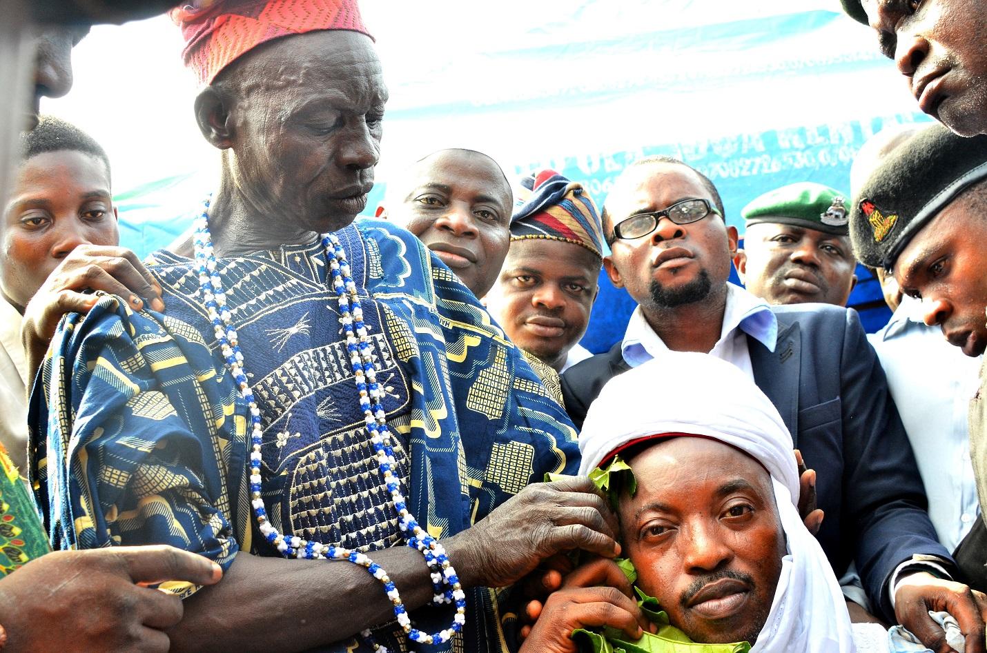 Newly installed Oluwo of Iwo, Oba Rasheed Adewale Akanbi being installed by Sobaloju of Iwoland, Chief  Safiriyu Aremu, during the Turbaning/Installation of the new Oluwo of Iwo, at Oluwo Palace, Iwo, State of Osun on Monday 9/11/2015.