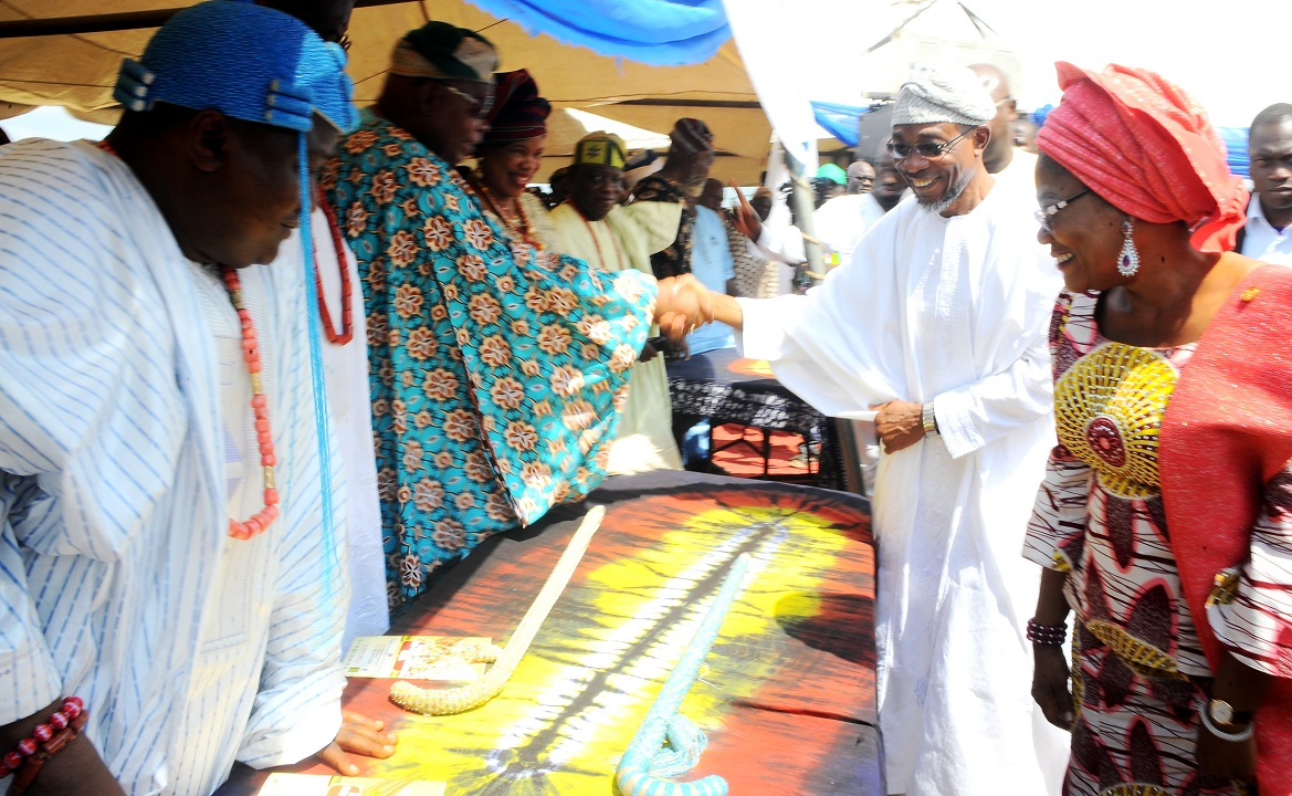 Governor State of Osun, Ogbeni Rauf Aregbesola and his Deputy, Mrs Titi Laoye-Tomori,  exchanging pleasnatries with Traditional Rulers, during the flag-off of the reconstruction of Olaiya Junction-Asubiaro-Ita Olokan Road, Osogbo, State of Osun on Friday 27-11-2015
