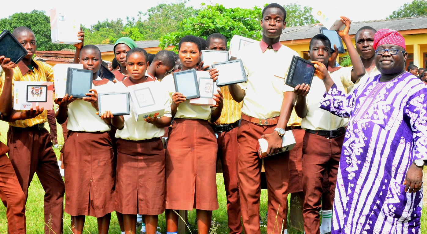 Permanent Secretary Ministry of Education, Mr. Lawrence Oyeniran presenting the Tablet of Knowledge (Opon Imo) to Students, during the second phase flag-off and distribution of Tablets of Knowledge to Senior Secondary School Students across the Public High Schools in the State, at the Adventist High School's Premises, on Friday 13-11-2015.