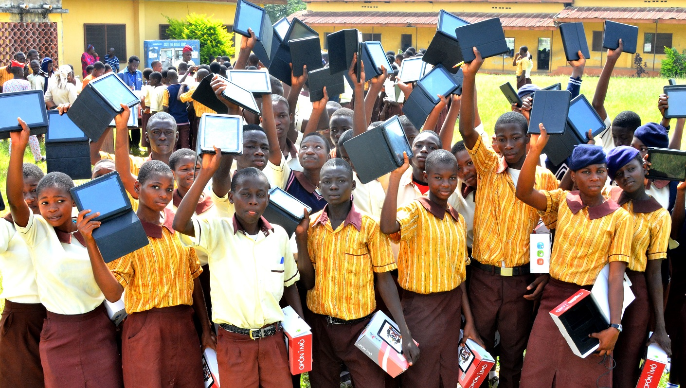 Cross section of SSS 3 Students of Adventist High School, Ede displaying theTablets of Knowledge (Opon Imo) given them by the State Government of Osun,  during the second phase flag-off and distribution of Tablets of Knowledge to Senior Secondary School Students across the Public High Schools in the State, at the Adventist High School's Premises, on Friday 13-11-2015.