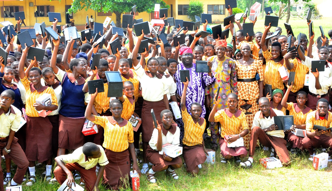 Permanent Secretary Ministry of Education, State of Osun, Mr.Lawrence Oyeniran (middle); Principal of Adventist High School, Ede, Mr Anthony Ojo and other teachers with some students, during the second phase flag-off and distribution of Tablets of Knowledge to Senior Secondary School Students across the Public High Schools in the State, at the Adventist High School's Premises, on Friday 13-11-2015.