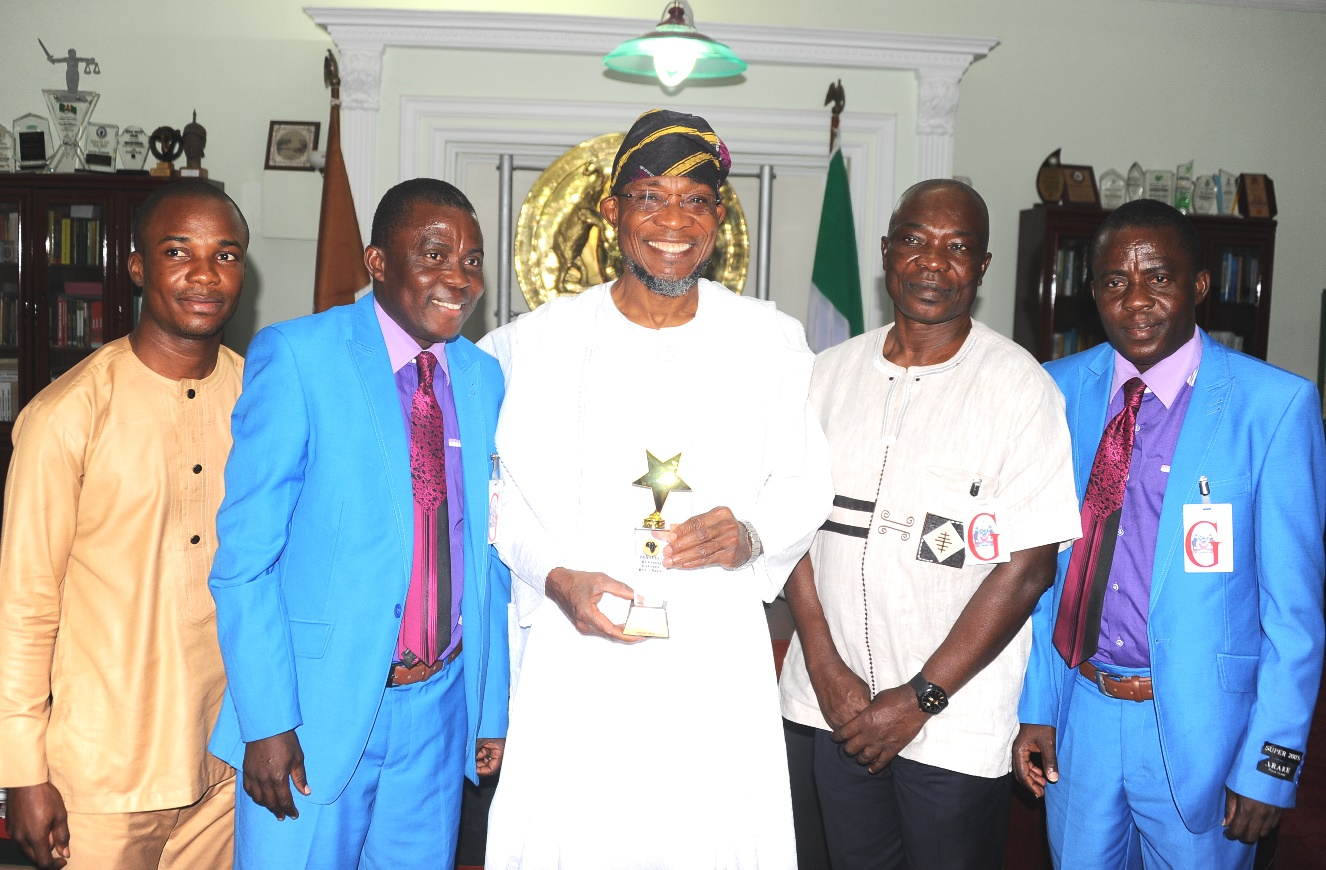 Governor State of Osun Ogbeni Rauf Aregbesola (3rd right); Consulate General of Ghana in Lagos, Mr Kwabena Appiah (2nd right); Reptesentatives of Pan African Historical Theatre Project (PANAFEST),Taiwo Oluwafunso (2nd left); his twins brother, Kehinde (right); 3rd Secretary Welfare, Protocol Ghana Consulate, Mr Edinam Hanyabul (left), during the Courtesy visit and Presentation of PANAFEST Out Standing Leadership Award to the Governor in his office at Government Secretariat Abere, Osogbo at the weekend