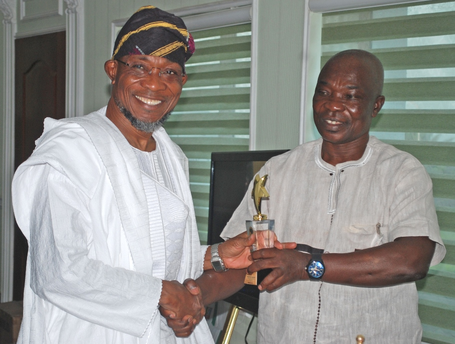 Governor State of Osun Ogbeni Rauf Aregbesola (left) Receiving the PANAFEST Award of Out Standing Leadership from Consulate General of Ghana in Lagos, Mr Kwabena Appiah, in his office at Government Secretariat, Abere, Osogbo at the wrekend