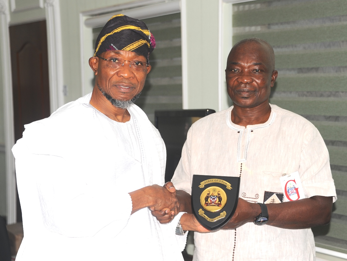 Governor State of Osun Ogbeni Rauf Aregbesola (left) Presenting a gift to Consulate General of Ghana in Lagos, Mr Kwabena Appiah, after the Presentation of PANAFEST Out Standing Leadership Award to the Governor in his office at Government Secretariat, Abere,  Osogbo at the weekend